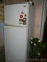 Холодильник и морозильную камеру